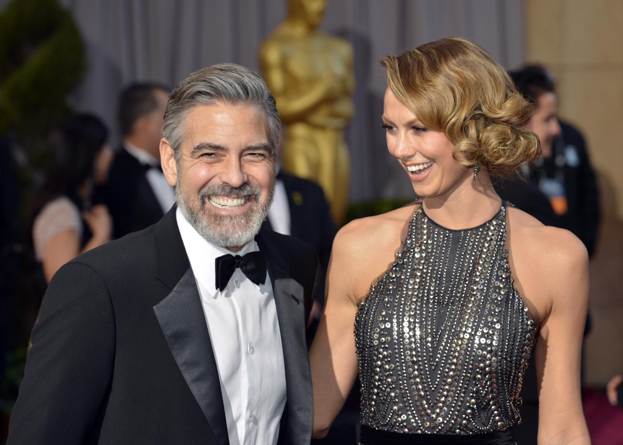 Actor George Clooney y Stacy Keibler